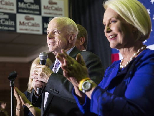 Sen. John McCain, with his wife, Cindy, speaks to his