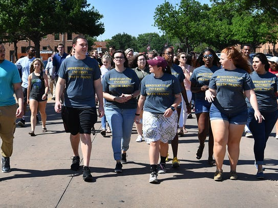A parade of Midwestern State University graduating