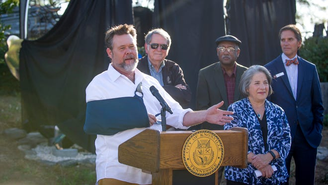 "Derek White, left, speaks more about his sculpture ""ki-net-ik"" as, from back left, Vice Mayor and city councilman Duane Grieve, councilman Daniel Brown, Mayor Madeline Rogero and councilman George Wallace listen on before the sculpture revealing on East Hill Avenue on Thursday, Oct. 13, 2016."