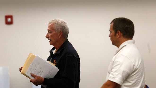 From left, Bloomfield Fire Department Chief George Duncan and Assistant Fire Chief John Mohler speak to the Bloomfield City Council during a meeting on Feb. 22 at Bloomfield City Hall.