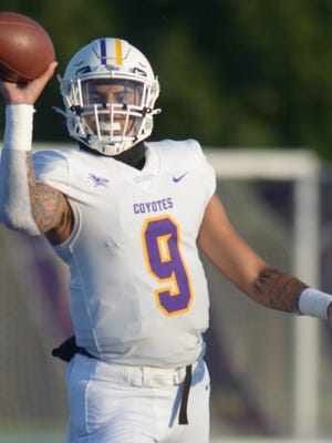 Kansas Wesleyan quarterback Isaiah Randalle prepares to throw a short pass in the first half of the Coyotes' season opener against Friends on Saturday at Graves Family Sports Complex.