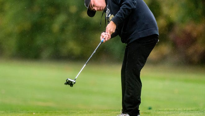 Springfield Sacred Heart-Griffin's Miles Roland putts on No. 2 during the Class 2A Richwoods Sectional golf championship Monday, Oct. 12, 2020 at Kellogg Golf Course in Peoria.