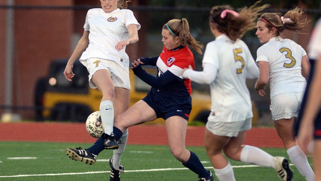 Byrd's Hope Miletello battles West Monroe's Faith Stansbury for the ball in a win earlier this season.