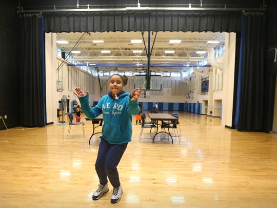 Sheleyana Tores, 10, of Rochester practices her step-dance moves during the after-school hours in the gymnasium at School 17 on Orchard Street in Rochester Monday, Oct. 19, 2015.