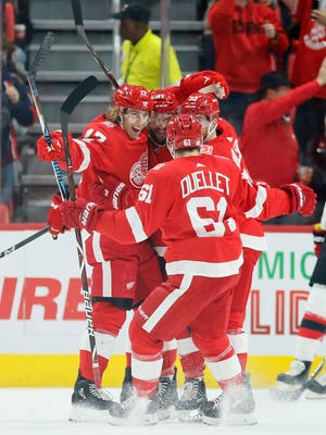 The Detroit Red Wings' David Booth (17) celebrates with teammates after his goal during the first period Saturday night.