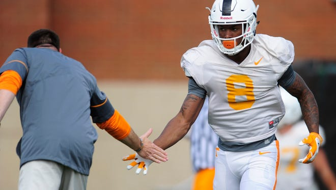 Tennessee head coach Butch Jones high-fives Latrell Williams during spring football practice at the Anderson Training Facility in Knoxville on Thursday, March 30, 2017.