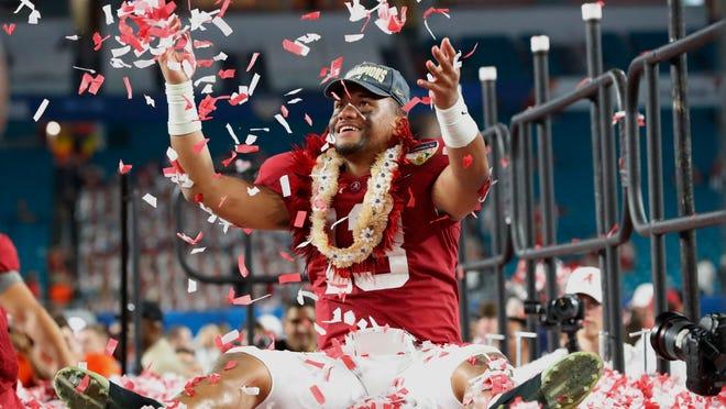 Alabama quarterback Tua Tagovailoa throws confetti in the air after winning the Orange Bowl NCAA college football game against Oklahoma, Sunday, Dec. 30, 2018, in Miami Gardens, Fla. Alabama defeated Oklahoma 45-34. (AP Photo/Wilfredo Lee)