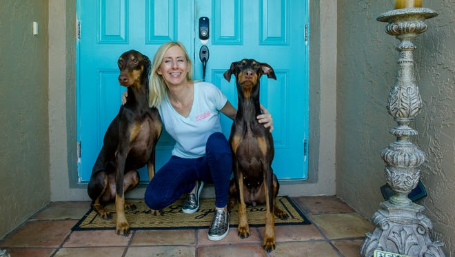 Carrie MonteLeon with dogs Chase and Thea