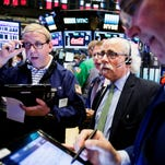 Traders work at the New York Stock Exchange on Friday as the markets react to the just-released jobs report.