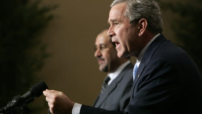 In this Thursday, Nov. 30, 2006 file photo, U.S. President George W. Bush speaks during a joint press conference with Iraqi Prime Minister Nouri al-Maliki in Amman, Jordan.
