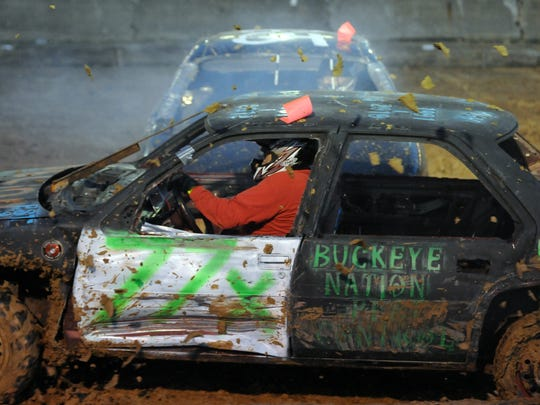 Jeff Keith, of Frazeysburg, is struck from the side during the Nation-Wide Demolition Derby at the Muskingum County Fair in 2015.