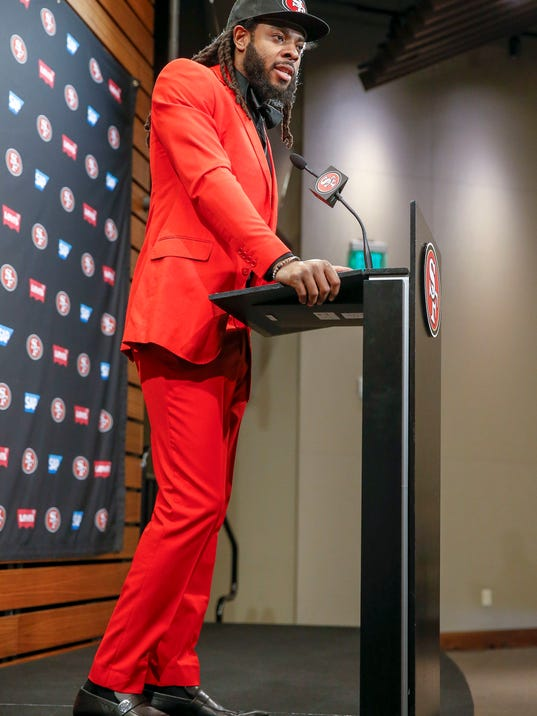 San Francisco 49ers new cornerback Richard Sherman answers questions during an NFL football news conference in Santa Clara, Calif., Tuesday, March 20, 2018. Sherman agreed to a three-year deal with the 49ers. (AP Photo/Tony Avelar)