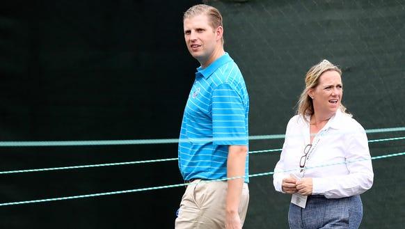 Eric Trump walks around the Trump National Golf Club