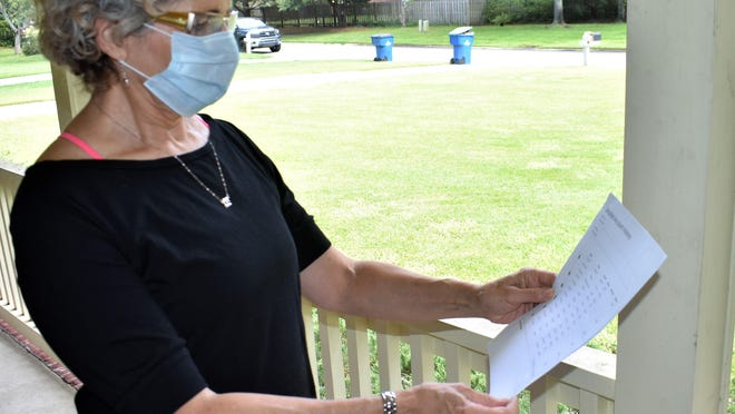 Bryan County resident Jean Iaderosa reviews a recent water bill from Water Utility Management and questions its accuracy.