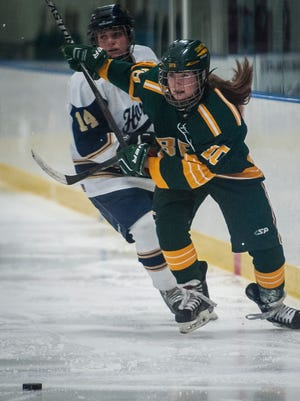 BFA St. Albans #10 Lizzy Hill sprints to the puck past Essex #14 Hannah Barrett during Wednesday night's girls hockey game at Essex. The Comets shut out the Hornets, 2-0.