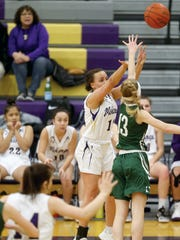 North Kitsap girls basketball player Olivia Selembo shoots a corner 3-pointer on Tuesday over Emilia Long of Port Angeles. Like players at all levels, high school basketball players are taking more 3-pointers now than ever before.