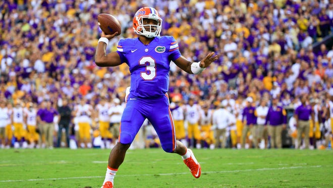 Florida Gators quarterback Treon Harris (3) throws against the LSU Tigers during the first half of a game at Tiger Stadium.