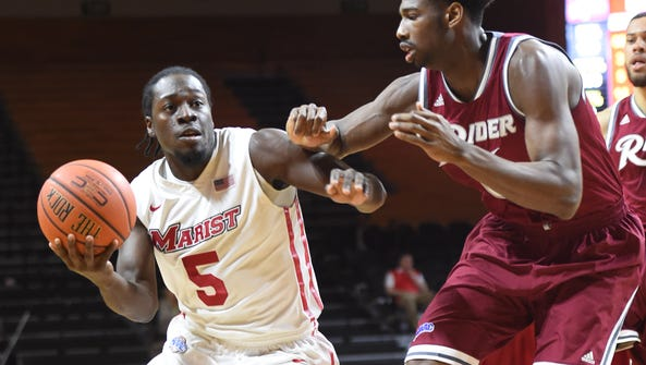 Marist College's Khallid Hart drives to the hoop against
