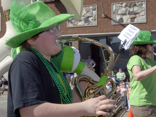 This young musician works hard as he marches in the