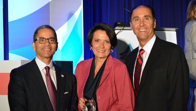 America's Essential Hospitals President and CEO Bruce Siegel, presents Lawrence Antonucci, Chief Operating Officer and Sally Jackson, System Director of Government and Community Relations for Lee Memorial Health System, with the America's Essential Hospitals' 2015 Gage Award. The association announced the winners at its annual conference, VITAL2015, in San Diego, June 25. The awards celebrate creative and successful programs that enhance patient care and meet community needs.