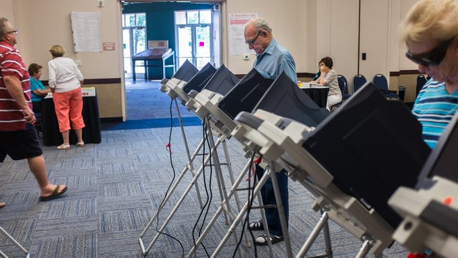 Doug Hafen casts his ballot during the primary election at the Dixie Center on Tuesday, June 6, 2014.