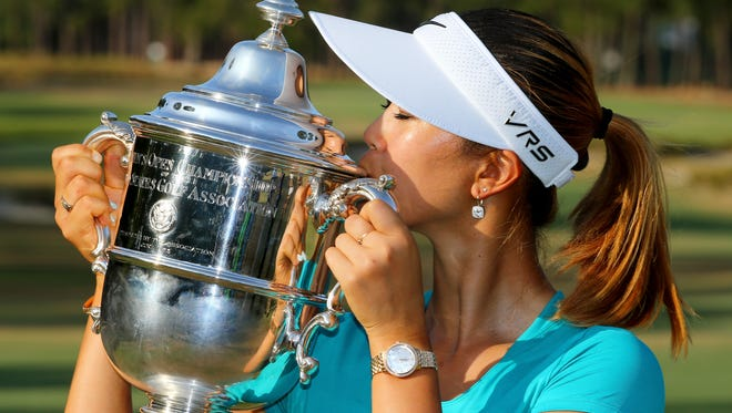 Michelle Wie of the United States celebrates with the trophy after winning in the final round of the 69th U.S. Women's Open at Pinehurst Resort & Country Club, Course No. 2 on June 22, 2014 in Pinehurst, North Carolina.