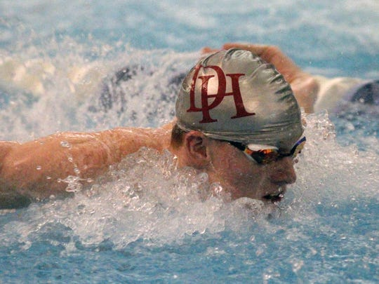 Dixie Heights'  Matthew Sims competes in the Boys 100 yard butterfly, Saturday, Saturday, Feb. 10.2018.