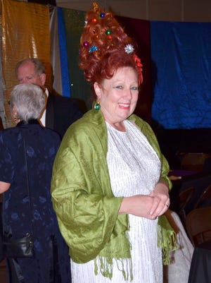 Robin Williams sports a Christmas tree hairdo at Saturday's Black Tie Benefit Ball, the annual, formal fundraiser for the Mimbres Region Arts Council.