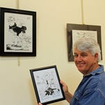 Cartoonist Ricky Nobile's artwork is on display in the living room room gallery at the Peck House, headquarters for the Osher Lifelong Learning Institute.