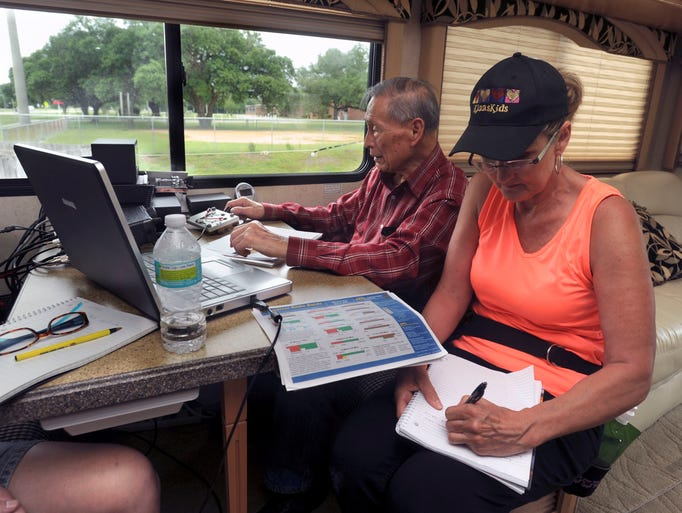 Desmond Yong works with continuous band (CW) radio as Debbie Carter logs call signs and locations Saturday during the Five Flags Amateur Radio Association's annual field day at the Escambia County Sheriff's Sub Station in Warrington. Desmond has been in amateur radio since 1947.