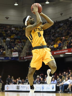 East Tennessee State's Desonta Bradford (11) leaps to the basket during the first half against UNC Greensboro in the Southern Conference tournament championship in Asheville, N.C.