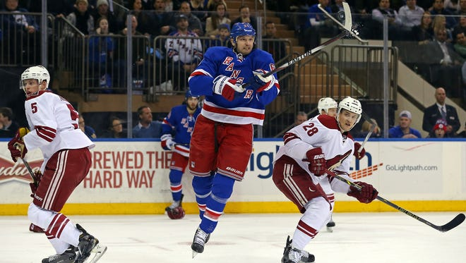 Feb 26, 2015: New York Rangers left wing Rick Nash (61) knocks the puck down in front of Arizona Coyotes left wing Lauri Korpikoski (28) during the second period at Madison Square Garden.