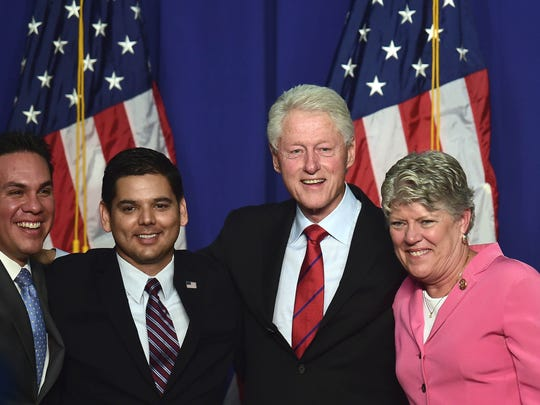 "Former US President Bill Clinton poses with California politicians, Pete Aguilar (L) Mayor of Redlands, Congressman Raul Ruiz (2-L) and Congresswoman Julia Brownley (R) in a show of support during a ""Get Out The Vote"" rally in Oxnard, California on October 29, 2014 in advance of the November 4 elections. Clinton was on hand at Oxnard College to help bolster support for Democrats in three local races: Rep. Raul Ruiz of Palm Desert, Rep. Julia Brownley of Westlake Village, and Redlands Mayor Pete Aguilar, who is running for the 31st Congressional District seat in San Bernardino County."