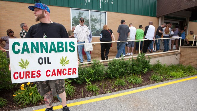 Darryl Lewis of Middletown stands outside the First State Compassion Center, the state's first medical marijuana dispensary, near Wilmington last June.