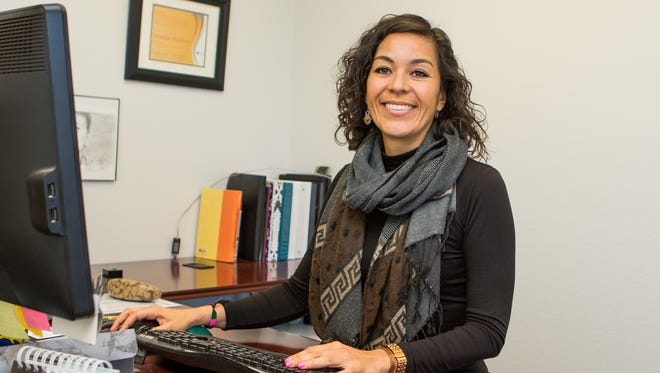 Program Manager Griselda Martinez of NMSU's Arrowhead Center is a vital link between creative work and the marketplace.