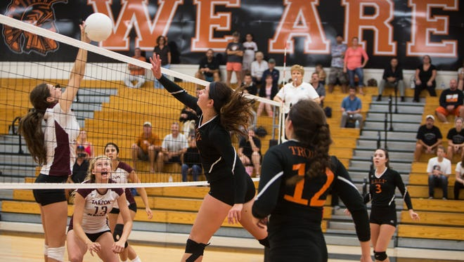 Jill Foster, #3, of Tarpon Springs blocks a hit from her opponent Emmanuelle Meurgue, #7, of Lely in a Class 5A regional semifinal volleyball match at Lely High School on Friday, Oct. 28, 2016.