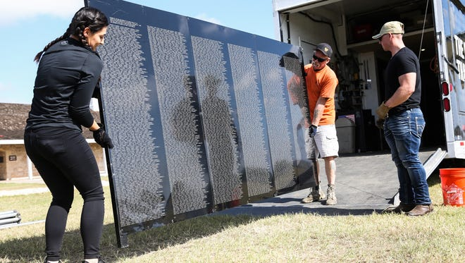 Marines carry a panel for The Wall That Heals for assembly Wednesday, Nov. 15, at Fort Concho.