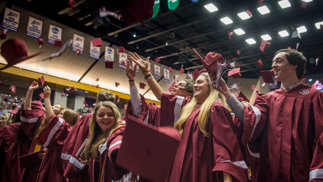 Graduates toss their caps during Franklin High School's graduation ceremony at Lipscomb University's Allen Arena, Saturday, May 21, 2016, in Nashville, Tenn.