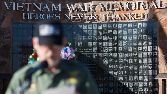 Bruce Fonnest, member of the Vietnam Veterans of America chapter 431of Las Cruces, reads off a list of 398 names of soldiers from New Mexico that died serving in Vietnam, during Welcome Home Vietnam Veterans ceremony at Veterans Park, Saturday March 25, 2017.
