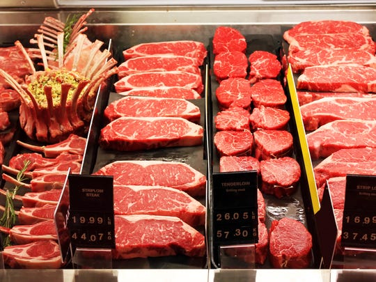 A butcher's shop displays a selection of cuts of beef