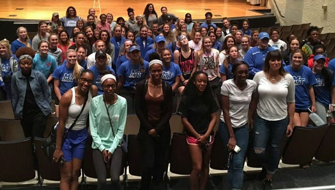 Brenda Tracy (center) with MTSU athletes on Wednesday night after sharing her story.