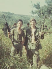 U.S. Army Pfc. James McCloughan, right, with a platoon interpreter whose life he saved in Nui Yon Hill in May 1969.