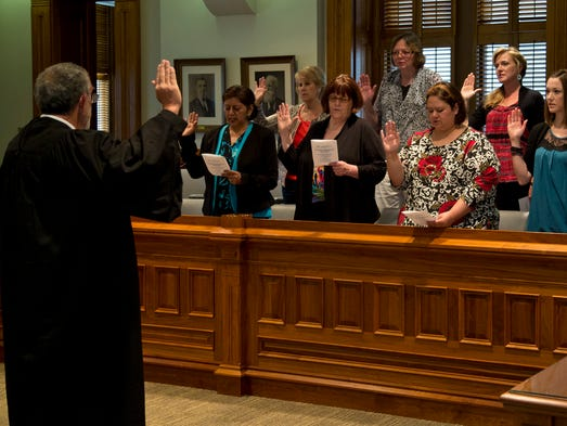 Tippecanoe Circuit Judge Don Daniel swears in the Tippecanoe Adults Guardianship Services volunteers Tuesday, June10, 2014, at the courthouse in Lafayette.