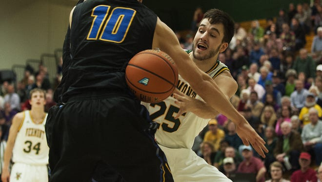 Catamounts forward Drew Urquhart (25) passes the ball around Santa Barbara forward Maxwell Kupchak (10) during the men's basketball game between the UC Santa Barbara Gauchos and the Vermont Catamounts at Patrick Gym on Wednesday night.