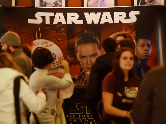People line up to get into Star Wars Thursday at Marcus Parkwood Cinema in Waite Park.