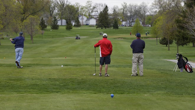 Golfers tee off Tuesday earlier this year at Lakeshore Municipal Golf Course in Oshkosh.