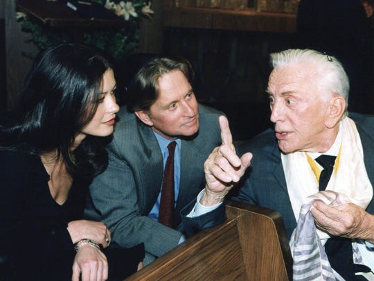Kirk Douglas with his son, Michael, and daughter-in-law
