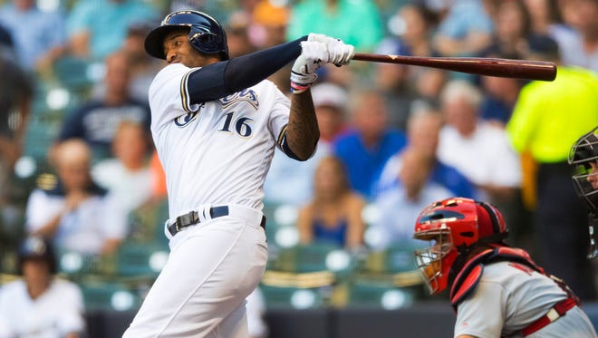 Right fielder Domingo Santana hits an RBI single during the first inning.