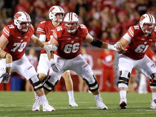 Wisconsin offensive lineman David Edwards (79), offensive lineman Beau Benzschawel (66) and offensive lineman Tyler Biadasz (61) provide pass protection during their game Friday, September 1, 2017 at Camp Randall Stadium in Madison, Wis. Wisconsin defeated Utah State 59-10.