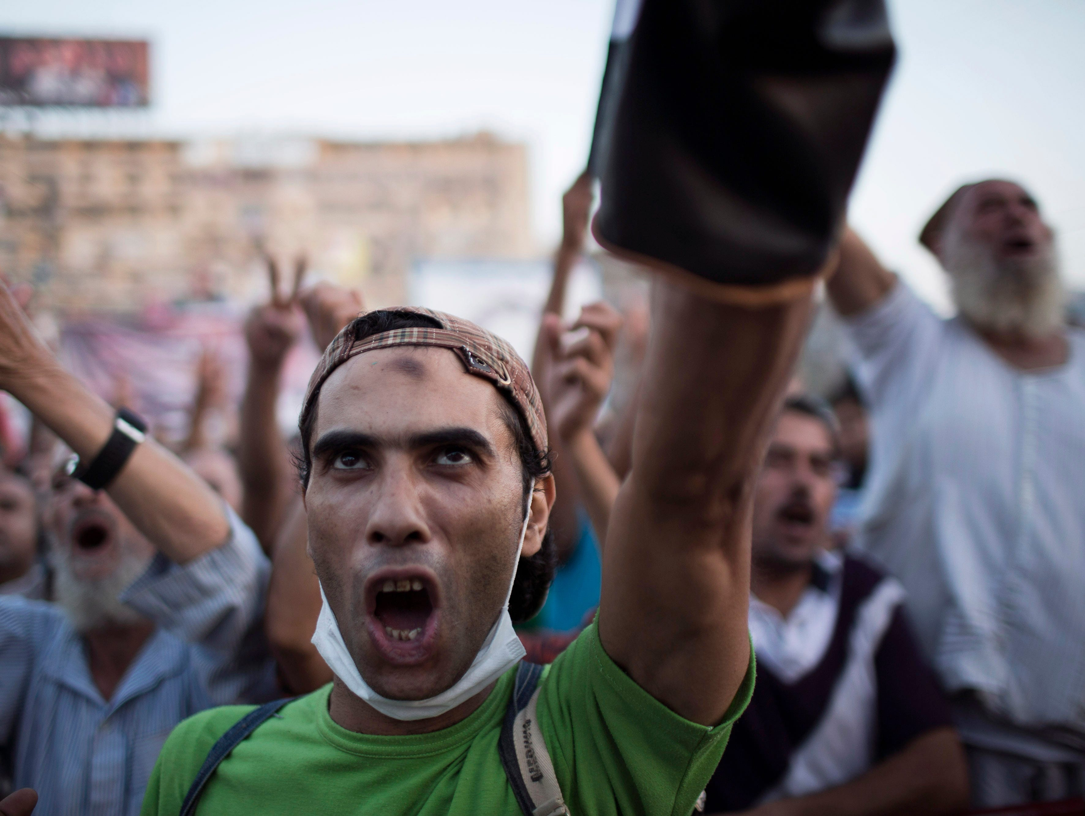 A supporter of Egypt's ousted President Mohammed Morsi chants slogans against the Egyptian Army during a protest on Aug. 12. By midday Egyptian police did not take action to disperse fortified protest camps despite security officials declaring Sunday that forces would besiege two sit-ins within 24 hours.